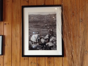 Framed MEM Donaldson photograph of children at St Columba's Well, Eigg, exhibited at Pier Café, Galmisdale, Eigg