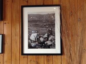 Framed MEM Donaldson photograph of children at St Columba's Well, Eigg, exhibited at Pier Café, Galmisdale, Eigg